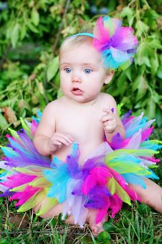 Pixie Princess This is an ABSOLUTELY ADORABLE fairy knotted FULL Boutique Tutu. Made with pink, fuschia, apple, turquoise, and purple