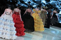 Models walk the runway during the Alexander McQueen Spring/Summer 2013 show as part of Paris Fashion Week. The bee-themed collection inspired these hats, similar to those found in beekeeper's outfits.� Photo Credit: Getty Images via StyleList