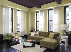 Benjamin Moore Paint Colors - Purple Living Room Ideas - Edgy, Original Purple Living Room - Paint Color Schemes . . . . . Take purple to new heights with a ceiling of deep Vintage Wine. . . . . . Ceiling - Vintage Wine (2116-20); Walls - Light Khaki (2148-40); Accent (curtain shades, lamp shade) - Mascarpone (AF-20).