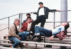 Drag racing, leather jacket, cigarette smoking? Yep! Secret sweet side? Check! John Travolta as Danny Zuko in Grease.