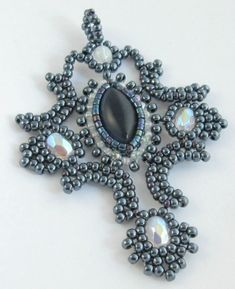 beaded cross http://www.pinterest.com/justsewhappy/beautiful-beaded-crosses/