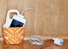 Very handy: turn a lotion bottle into a phone charging station that hides cords.