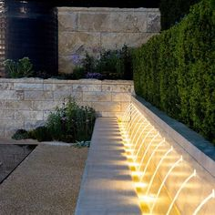 Water feature with illuminating effects. RHS Chelsea. Andrew Ewing
