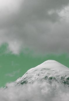 clouds above and below the peak