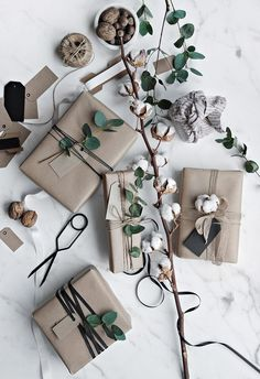 When it comes to wrapping presents there are many ways to do it, I personally prefer the simplicity of the Scandinavian way so this years theme was very much based on that style. I used paper drop clo