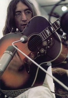 "soundsof71:  "" John Lennon, working on the album Let It Be  """