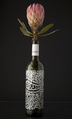 Protea bottle used as a vase Valentine Hotel, Valentines, Protea Flower, Empty Bottles, Wedding Tables, 50 Shades, Save Yourself, Wine Tasting, Flower Power