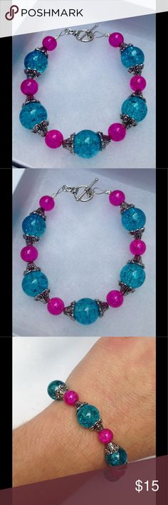 "Blue and Pink Sparkly Glass Bracelet This lovely bracelet is made with sparkling blue and pink glass beads. It measures about 7.5"" long and attaches with a silver tone toggle clasp.   All PeaceFrog jewelry items are handmade by me! Let me know if you need me to adjust the size. Take a look through my boutique for coordinating jewelry and more unique creations! PeaceFrog Jewelry Bracelets"