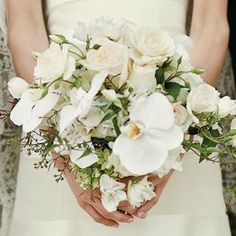Free-Form White Bouquet | This white bouquet strays from the typical rounded version most brides opt to carry. | SouthernLiving.com