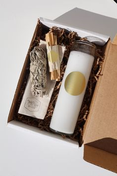 Our Good Vibes Set features an unscented glass pillar candle, set of three  palo santo sticks, one sage smudge stick, and a white matchbox.       * Features palo santo, smudge stick, one tall pillar candle, and one       matchbox     * Perfect for gifting     * Packaged in a custom drawstring bag and gift box
