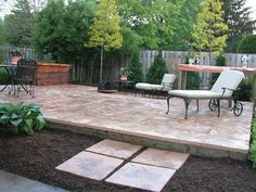 this home owner extended the existing concrete patio with rock ... - Raised Concrete Patio Ideas