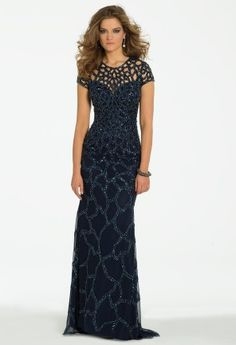 Elegance comes in many designs and styles but this long beaded dress is a strong contender in the chic sophisticated dress contest! This dress brings a sexy illusion while still keeping the classy allure that you love. Beaded spider cutout lattice embraces the entire neckline