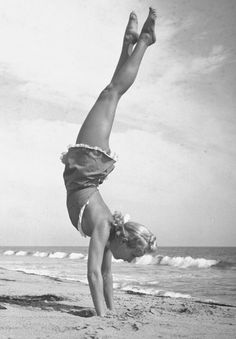 Betty Grable does handstand on local beach - for life mag