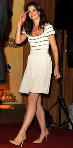 Look of the Day › December 18, 2010 WHAT SHE WORE Holmes announced the Golden Globe nominations in a chic striped Azzaro cocktail dress and pointy-toe Jimmy Choo nude heels.