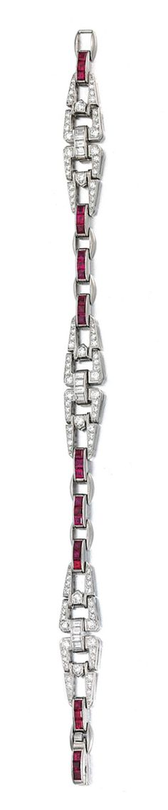 RUBY AND DIAMOND BRACELET, CIRCA 1920.  Designed as a series of open work geometric links set with calibré-cut rubies, circular-, single-cut baguette diamonds, length approximately 180mm, signed JEC & Co, numbered.