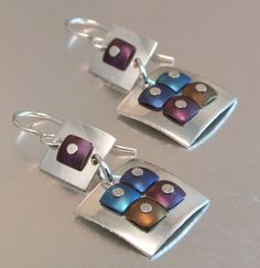 Melody Armstrong - Sterling silver, anodized titanium.  Anodized titanium square rivets.  Sterling silver hooks.