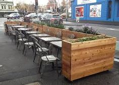 Image result for outdoor cafe seating with planters