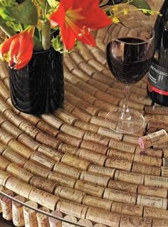home decorations made with wine bottle corks would look really cute with wooden wash barrel beneath it!