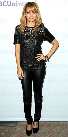 Nicole Richie attended NBC's summer press day in a laser-cut top and leather leggings that she styled with stacked bangles, gold rings and black pumps