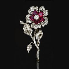 PROPERTY OF A EUROPEAN COLLECTOR RUBY AND DIAMOND BROOCH, VAN CLEEF & ARPELS, 1952. Designed as a flower, the petals set with oval rubies and brilliant-cut diamonds, the stem set with baguette stones, to brilliant-cut diamond set leaves, mounted in platinum, Estimate    14,914 - 23,199USD  LOT SOLD. 18,642 USD