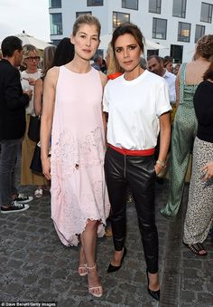 Statement: Victoria donned a pair of coordinating black heels as she posed alongside her stunning pal Rosamund Pike