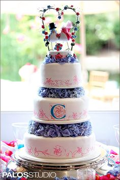 Pink and blue wedding cake (24) but with a different topping