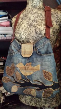 One of my favorite, appliqué repurposed jeans to bag with recycled leather belt.