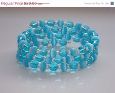33%OFF Sky Blue Cats Eye Wrap Bracelet by EriniJewel on Etsy