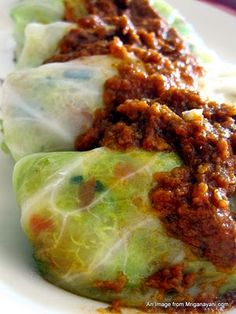 quinoa stuffed cabbage roll.  use quinoa, onions, red bell peppers, yellow zucchini and green zucchini. You can use anything your heart desires..