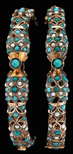 Turquoise Soul  . . .    Two yellow gold turquoise and seed pearl 'serpent' bangles   Each featuring pierced double-headed 'serpent' design accented by seed pearls and turquoise beads, ruby 'eyes'.