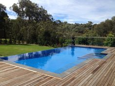 Pool, Simple And Stylish Designs Ideas Pictures Of Infinity Pools With Dark Wooden Deck For Backyard Or Modern Contemporary House With Green And Fresh Panoramas: Beautiful Design Pictures of Infinity Pools