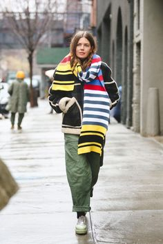 37458149bc3bbd Street style from New York Fashion Week is providing us with endless  layering inspiration.