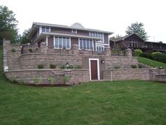 Use hardscaping to beautify a basement entrance. How welcoming is this beautiful lakeside home?