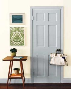 Liven up a room by painting an interior door in a contrasting (yet complimentary) color.
