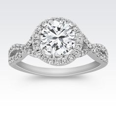 Halo Infinity Diamond Engagement Ring with Brilliant Round Diamond from Shane Co. Available with your choice of ruby, diamond or sapphire center stone.