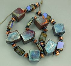 Raku and Czech Glass Focal Bead Set by elementspottery on Etsy, $25.00