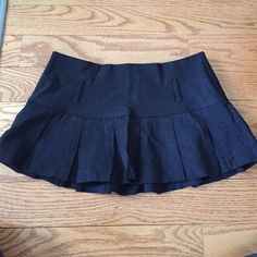 Sexy black skirt. DIY costume Cute black skirt. Pretty short. Used to wear when bartending lol. There is no size tag but I would say it would fit about a size 5 Charlotte Russe Skirts