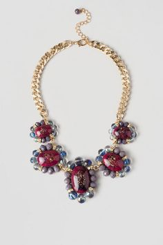"""Finish off youroutfit with the Carlyle Statement Necklace. The deep reds & purples of the stones in this necklace give off a luxurious feelwhile the thick gold chain gives it an updated look. Pair this with a simple dress toallowthe necklace to stand out!<br /> <br /> - Finished with a lobster claw clasp<br /> - 17"""" length<br /> - 3"""" extension<br /> - Lead & nickel free<br /> - Imported"""