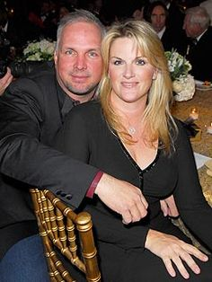 Trisha ~Yearwood and Garth Brooks  Saw them in concert when i was little!