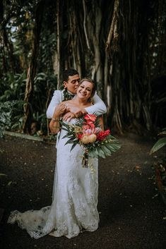 Obsessed with this Tropical Hawaii Wedding at Haiku Gardens Wedding Venue in Oahu. After the whimsical wedding ceremony, we snuck out for some bride and groom photos in the lush green jungle! The brides elegant lace wedding dress and the grooms all white grooms suit looked beautiful with the tropical floral details - Hawaii Wedding Photographer Blue Bridesmaids, Blue Bridesmaid Dresses, Maui Weddings, Hawaii Wedding, Wedding Ceremony, Lace Wedding, Wedding Dress, Whimsical Wedding Inspiration, Maui Wedding Photographer