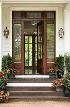 ..beautiful door enhanced by lovely blooming plants...
