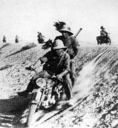 Italian soldiers on a Moto Guzzi riding near the Qattara Depression during the Axis advance on El Alamein