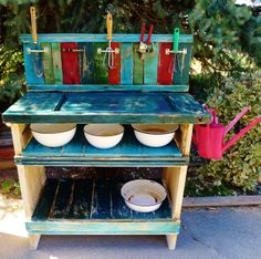 I made this fun potting bench from old doors.  I added pallet wood for shelves and the back rest.  I added old door handles to hold the tools and old railroad tie nails to hold the watering cans