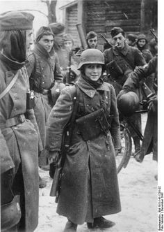 """Photographed near Golobovo, Russia in December 1941, Léon Merdjian at 15 was one of the youngest soldiers in the collaborationist French Legion of Volunteers Against Bolshevism (Légion des Volontaires Français Contre le Bolchévisme, or """"LVF""""). He was born at Tbilisi, Georgia, emigrated to France, and became a medic in the German army. Bundesarchiv Bild 101I-141-1291-02"""