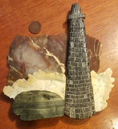 """""""THOSE IN PERIL"""" [#2 of 3] LIGHTHOUSE  From two piece Ship & Lighthouse set of hand-carved stone art on matching Jasper slabs. By Robert Dennis Wilson [""""WE ROCK!""""] $500 + shipping."""