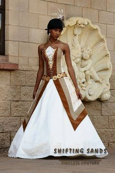 Miriam - Shifting Sands Traditional African Gold and brown porcupine dress with beaded details. Couples African Outfits, African Attire, African Wear, African Dress, Xhosa Attire, African Fashion Designers, African Inspired Fashion, African Print Fashion, African Prints