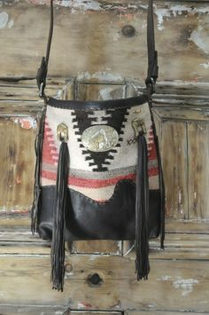 Leather & a Native Blanket.  Buckles are a great trim.