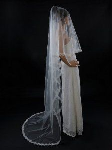 Topwedding 1 Tier Cathedral Length Voile Wedding Veil with Appliqued Edge, Ivory by Topwedding. $38.89. Made of Voile without comb. Features of appliques. The veil can be worn beautifully with any hairstyle and worn with feather/flower accessories.. Length of 59*118 inches/150*300cm. Graceful 1 layer cathedral length wedding veil. Are you looking for a piece of filmy voile that can enhance your gown on your special day? Ok, this one-tier veil can be your perfect choice. Its hem i...
