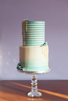 Lemon drizzle cake and chocolate fudge cake in 2 tiers with buttercream stripes and a water colour ombre effect and asymetric white chocolate drip. Chocolate Fudge Cake, Chocolate Drip, White Chocolate, Drip Cakes, Beautiful Cakes, Amazing Cakes, Aqua Blue, Blue Drip Cake, Striped Cake