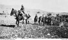 "British Take Beersheba After Cavalry Charge ""An Australian cavalryman escorting Turkish prisoners after the capture of Beersheba. "" October 31 Beersheba–After extensive preparations, the British."